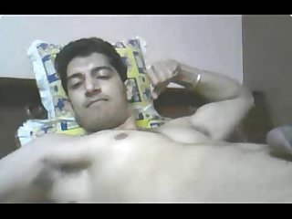 Indian guy cums while flexing muscles